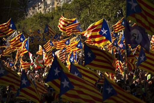 Catalans with estelada or independence flags gather during the Catalan National Day in Barcelona Spain