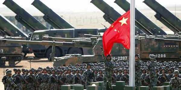 In this July 30, 2017 photo released by China's Xinhua News Agency, Chinese People's Liberation Army (PLA) troops perform a flag raising ceremony for a military parade to commemorate the 90th anniversary of the founding of the PLA on August 1 at Zhurihe training base in north China's Inner Mongolia Autonomous Region. China has said it is planning a small scale military operation to expel India troops from the disputed area of Doklam in the border between India, China and Bhutan after a weeks-long standoff.  (Pang Xinglei/Xinhua via AP)