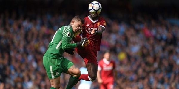196eba7832f Liverpool s Senegalese midfielder Sadio Mane (R) is sent off for this  challenge on Manchester City s Brazilian goalkeeper Ederson during the EPL  match.