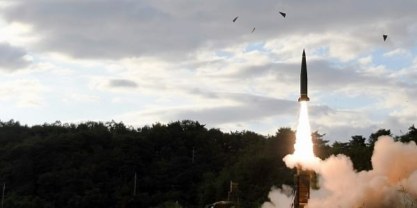 Acting in response to North Korea's missile launch, in this photo provided by South Korea Defense Ministry, South Korea's Hyunmoo II ballistic missile is fired during an exercise at an undisclosed location in South Korea. | AP