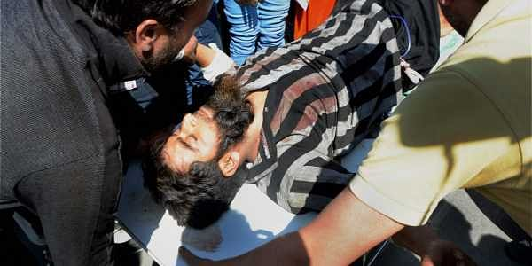One of the civilians injured in grenade attack in Tral's bus stand was brought to hospital in Srinagar. | PTI