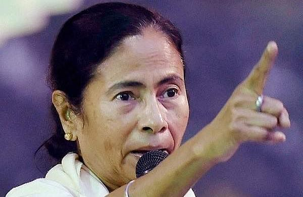 West Bengal Chief Minister Mamata Banerjee addresses AITMC in front of the main gate of RBI during the 3rd day of their protest dharna against the Centre demonetisation move in Kolkata in January. (File Photo | PTI)