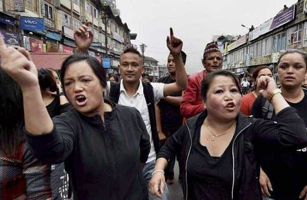 The Gorkha Janmukti Morcha (GJM) and other hill parties took out rallies demanding that the Centre should immediately intervene and start the dialogue process considering the sentiments of the people of the hills. In pic: Activists of GJM take out rally in Darjeeling.(Photo | PTI)