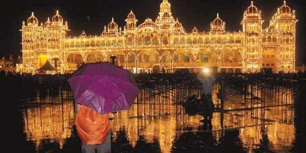 The Reflection Of Beautifully Illuminated Palace In Rain Water Mysuru On Sunday Evening People Perform Yoga Front