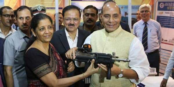 Defence Minister Nirmala Sitharaman and Home Minister Rajnath Singh having a feel of carbine indigenously produced by Ordnance Factory handed over to paramilitary forces for user trials. (Express Photo Service | Shekhar Yadav)