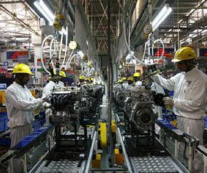 Employees work inside Maruti Suzuki's petrol engine plant on the outskirts of New Delhi. (File photo   Reuters)