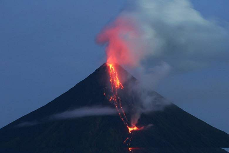 Philippine Mayon volcano 'fireworks' draw tourists as residents flee