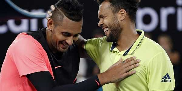 France's Jo-Wilfried Tsonga, right, congratulates Australia's Nick Kyrgios after Kyrgios won their third round match.