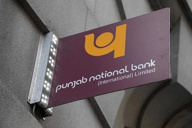 The logo of Punjab National Bank is seen outside of a branch of the bank. | REUTERS
