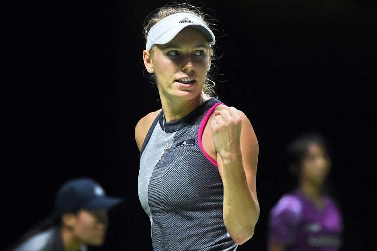 Caroline Wozniacki of Denmark reacts after a point against Karolina Pliskova of Czech Republic during the WTA Finals tennis tournament in Singapore. | AFP