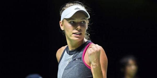 Caroline Wozniacki of Denmark reacts after a point against Karolina Pliskova of Czech Republic during the WTA Finals tennis tournament in Singapore. | AFP