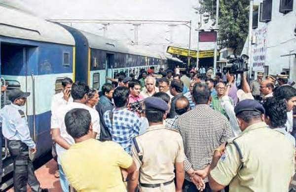 Passengers staging a protest at Vijayawada Railway Station on Friday
