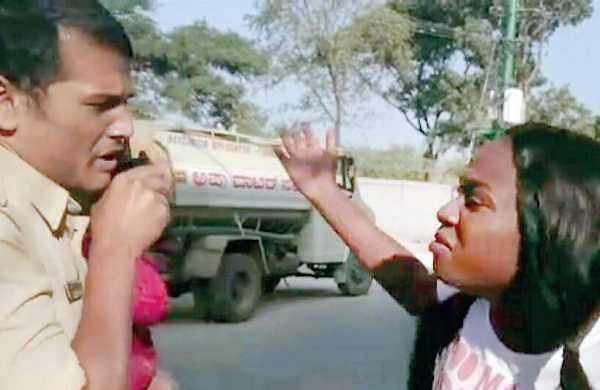 A Congolese student attacking a cop after being questioned for reckless driving at HBR Layout in Bengaluru recently