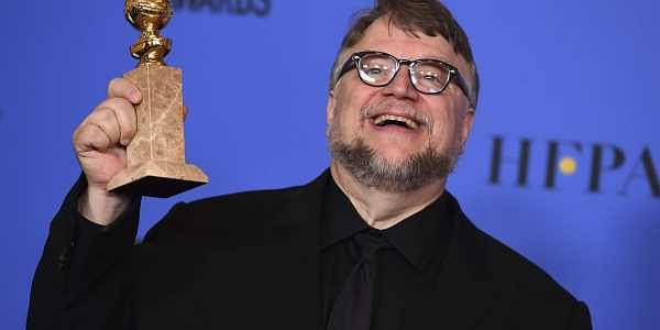A file image of Guillermo del Toro posing in the press room with the award for best director  for 'The Shape of Water' at the 75th annual Golden Globe Awards. (Photo | AP)