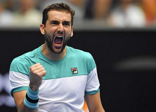 Cilic wins 100th Grand Slam match, advances to Open quarters