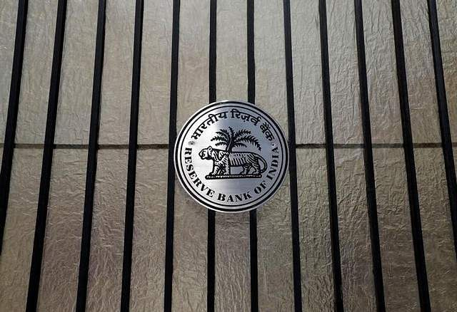 JHf India (RBI) logo is seen at the entrance gate of its headquarters in Mumbai. | REUTERS