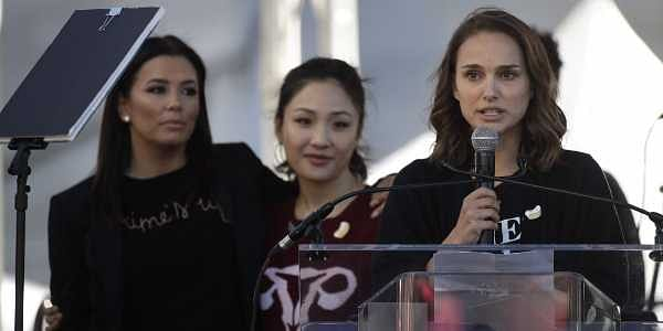 Actress Natalie Portman (right) speaks as she is joined by Eva Longoria, background left, and Constance Wu at a Women's March against sexual violence. (Photo | AP)
