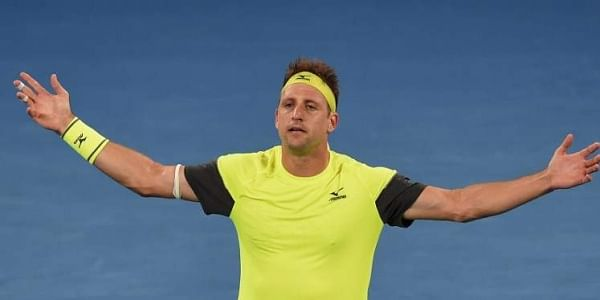 Tennys Sandgren of the US celebrates beating Austria's Dominic Thiem in their men's singles fourth round match on day eight of the Australian Open tennis tournament in Melbourne. | AFP