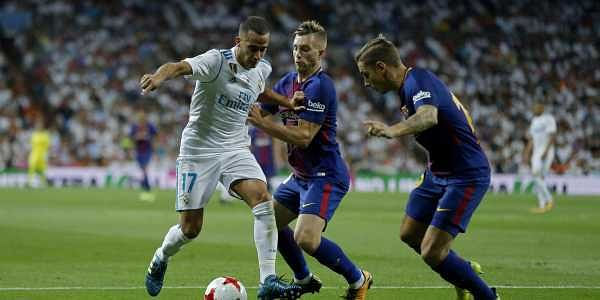 Real Madrid's Lucas Vazquez, left, in action with Barcelona's Gerard Deulofeu, centre, and Lucas Digne during the Spanish Super Cup second leg soccer match. | AP