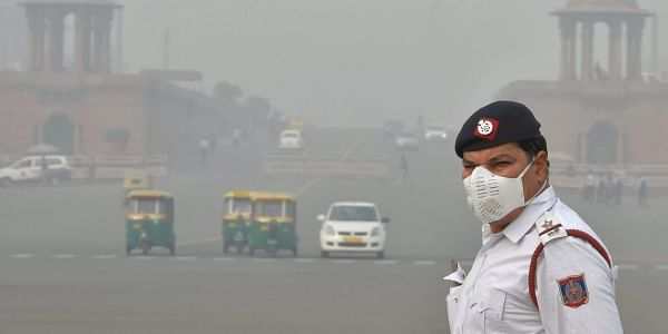A traffic policeman wearing an anti-pollution mask mans traffic amid smog and air pollution in New Delhi. | PTI File Photo