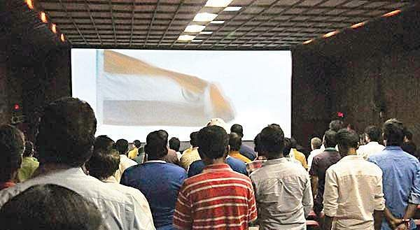Representational image. People standing for national anthem in a cinema hall