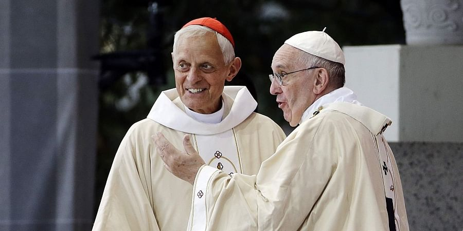 FILE - This Wednesday, Sept. 23, 2015 file photo shows Cardinal Donald Wuerl, archbishop of Washington, left, talking with Pope Francis after a Mass in the Basilica of the National Shrine of the Immaculate Conception in Washington. (Photo | AP)