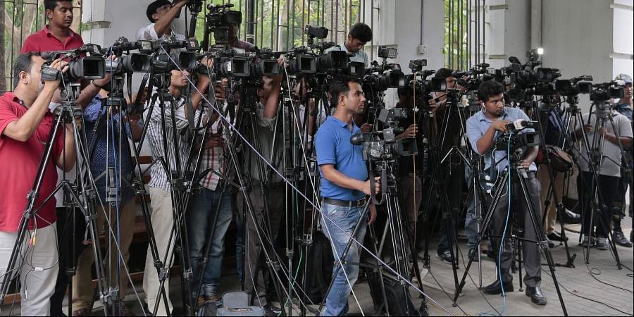 Bangladeshi journalists cover proceedings outside a court in Dhaka, Bangladesh. (Photo | AP)