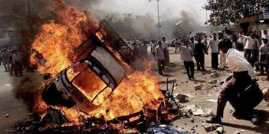 Vehicles on fire in Ahmedabad, India, on Feb. 28, 2002, the day 69 Muslims, mostly women and children, died in a compound set ablaze by thousands of Hindu men armed with stones, iron rods and bombs. (Photo | AP)