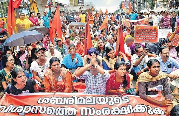Members of Sabarimala Samrakshana Samithi staging a protest by blocking Vyttila Junction against the Supreme Court verdict on Sabarimala in Kochi on Tuesday (Photo | EPS)
