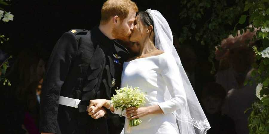 In this Saturday, May 19, 2018 file photo, Britain's Prince Harry and Meghan Markle leave after their wedding ceremony at St. George's Chapel in Windsor Castle in Windsor, near London, England. | AP