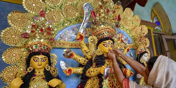 An idol of Goddess Durga being decorated with gold ornaments at a traditional 189 years old puja house on Mahashasthi of Durga Puja festival in Kolkata Monday Oct 15 2018. | PTI