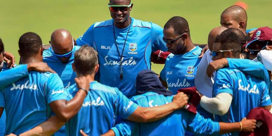 West Indies' captain Jason Holder with the teammates during a practice session ahead of the first cricket test match against India in Rajkot. (File | PTI)