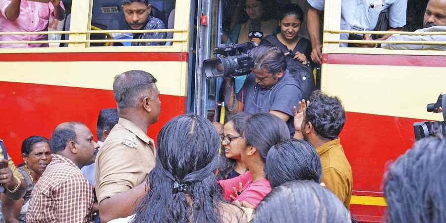 Sabarimala: Angry protestors attack women devotees seeking entry, police looks on