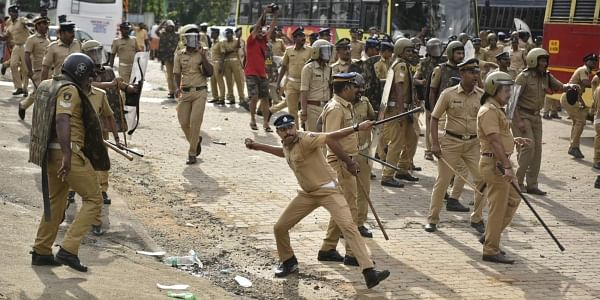 A policeman throws back a stone as they clash with protestors who tried to stop women of menstruating age from going to the Sabarimala temple at Nilackal, a base camp on way to the mountain shrine in Kerala, India, Wednesday, October 17, 2018. | AP