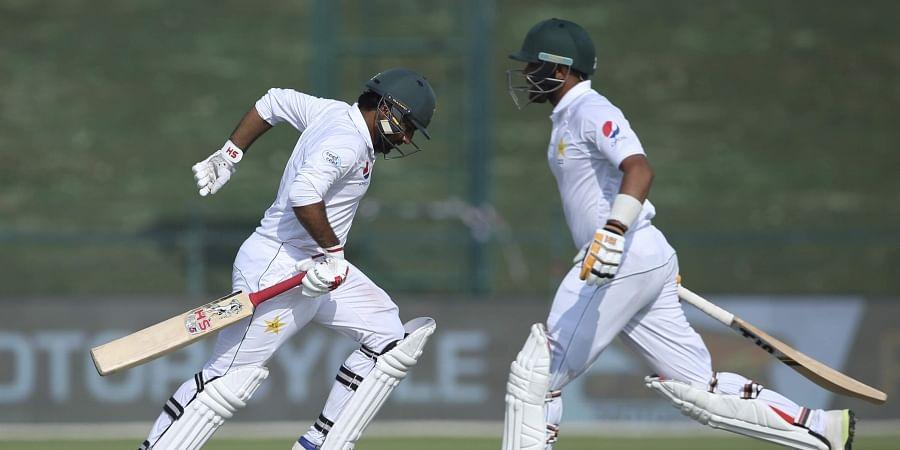 Pakistan's Sarfaraz Ahmed, left, and Babar Azam, run between the wickets against Australia during their test match in Abu Dhabi. (Photo | AP)