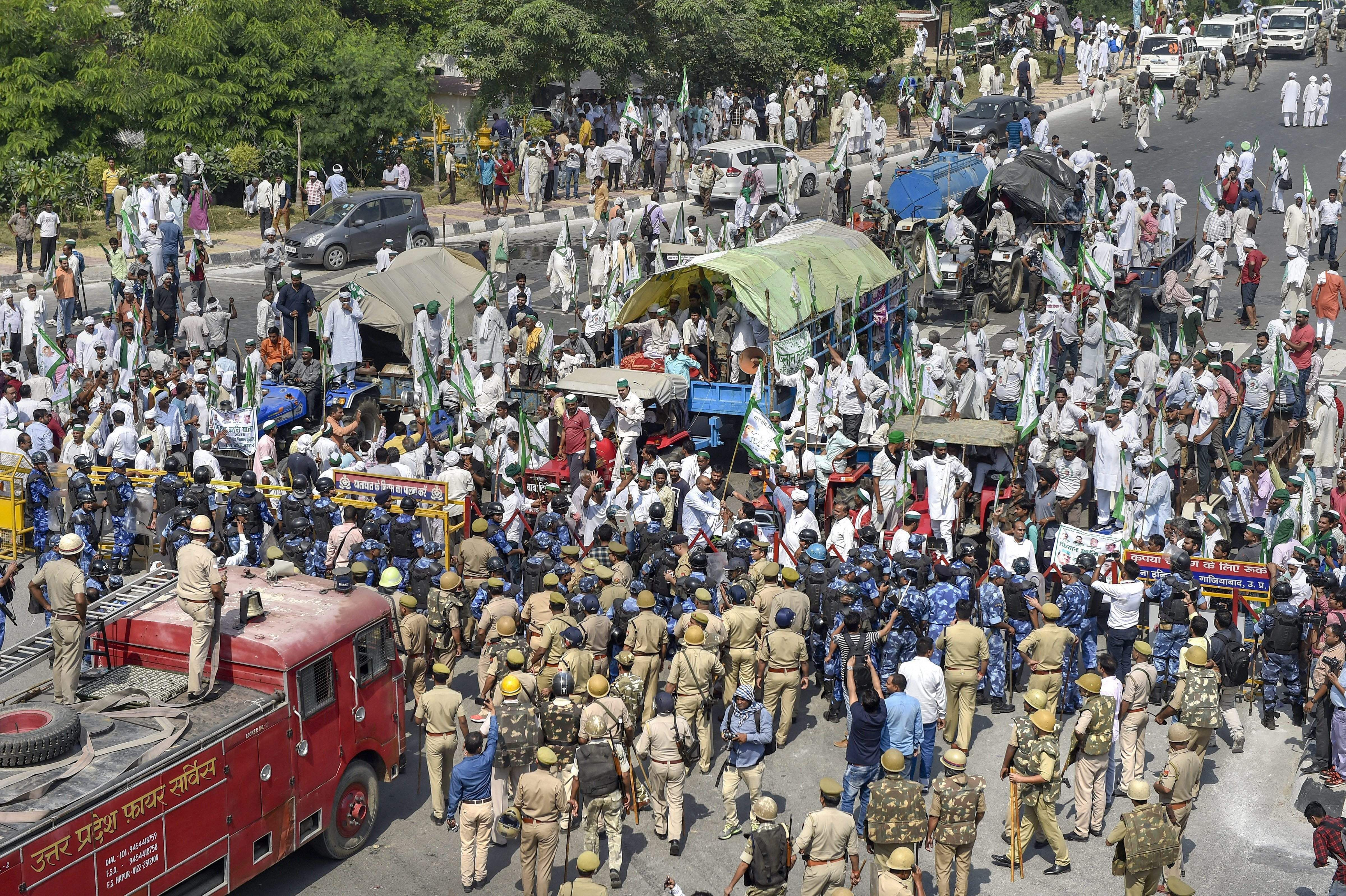 In image: Police and Rapid Action Force personnel try to disperse farmers protesting at Delhi-UP border during 'Kisan Kranti Padyatra' in New Delhi on Tuesday Oct 2 2018.   PTI