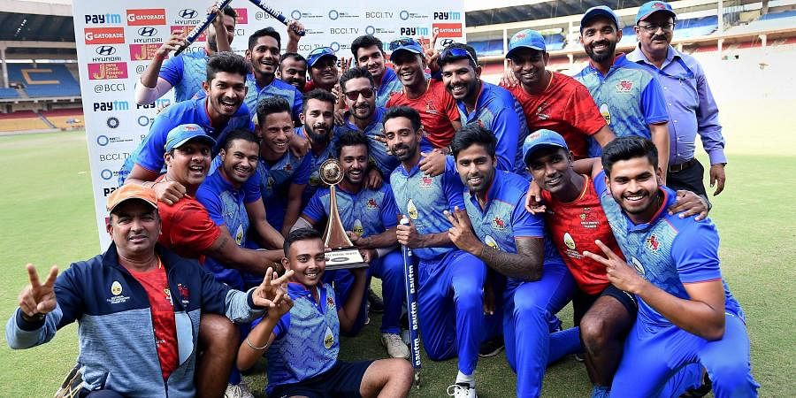Mumbai players pose with the trophy after beating Delhi in Vijay Hazare trophy final match. (Photo   PTI)