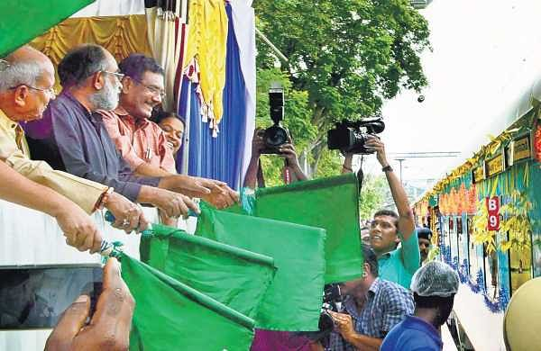 Union Minister of State for Culture and Tourism Alphons Kannanthanam flagging off the  Kochuveli - Banaswadi Humsafar Express at Kochuveli railway station on Saturday. A Sampath MP and O Rajagopal MLA are also seen | Express