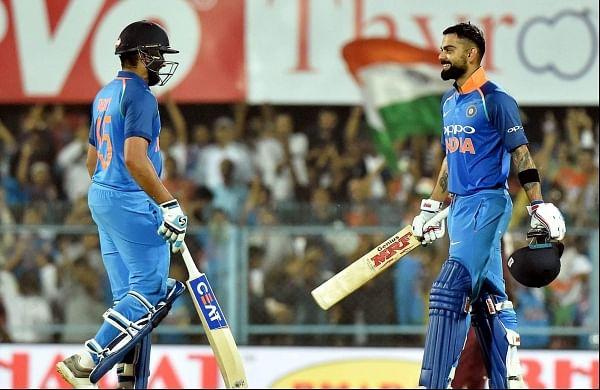 Virat Kohli celebrates his century with teammate Rohit Sharma during the first One Day International cricket match against West Indies at ACA Cricket Stadium Barsapara in Guwahati, Oct 21 2018. (Photo | PTI)