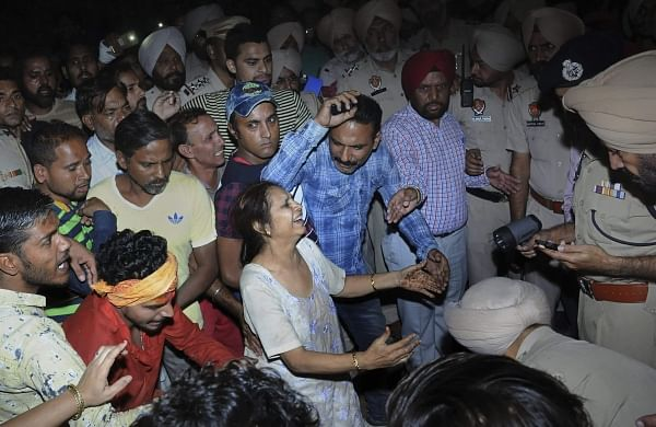 Relatives mourn at the site of a train accident at Joda Phatak in Amritsar. | PTI