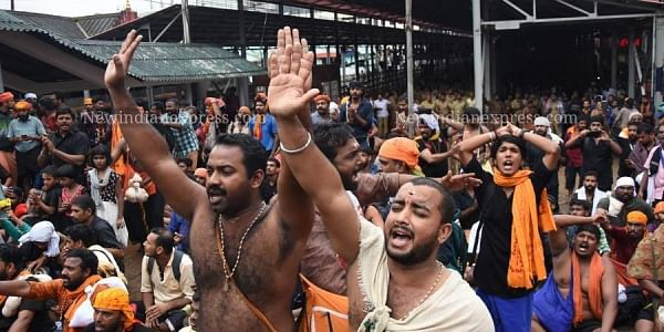 Devotees protest at the foot of the sacred 'Padhinettampadi' against the two women who attempted to enter Sabarimala hill shrine on October 19, 2018. (Photo | BP Deepu/ EPS)