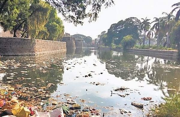Garbage strewn in a moat adjacent to Gagan Mahal in Vijayapura. | Express Photo Services