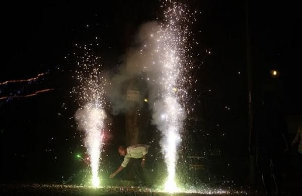 An Indian man lights firecrackers on the street during the New Year celebration in Mumbai, India, Friday, Jan. 1, 2016. | (File  | AP)