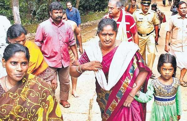 Female devotees return to the base camp after their progress was blocked by protesters guarding the Ayyappa temple on Monday | Shaji Vettipuram