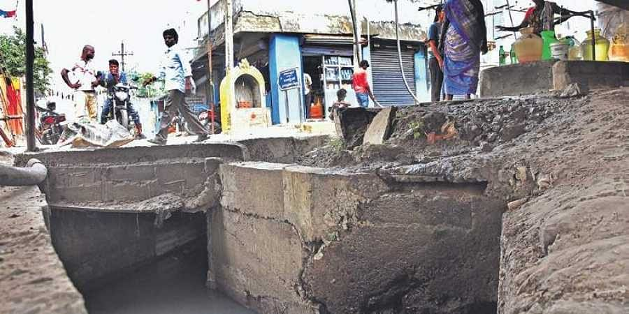 Cracks under murky waters the new indian express for Raw sewage under house