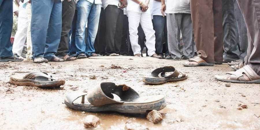 The two workers, K Rambabu and P Venkateswarlu, had died of suffocation after getting into an 18-ft deep manhole to clear clogged sewer lines at Bhavanipuram. | Express File Photo
