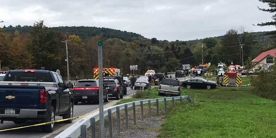 In this Saturday, Oct. 6, 2018 photo, emergency personnel respond to the scene of a deadly crash in Schoharie, N.Y. (PHOTO | AP)