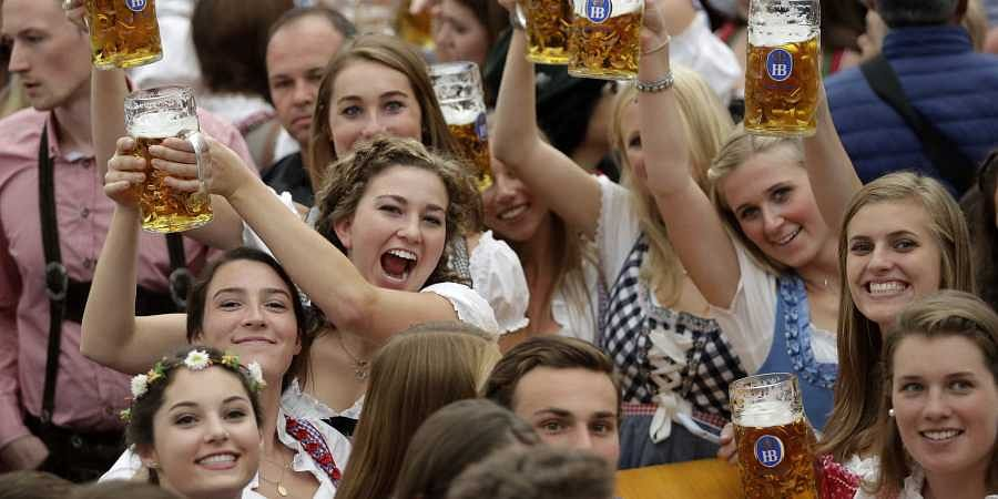 FILE-In this Oct. 7, 2018 file photo young women lift glasses of beer during the opening of the 185th 'Oktoberfest' beer festival in Munich, Germany. (Photo | AP)