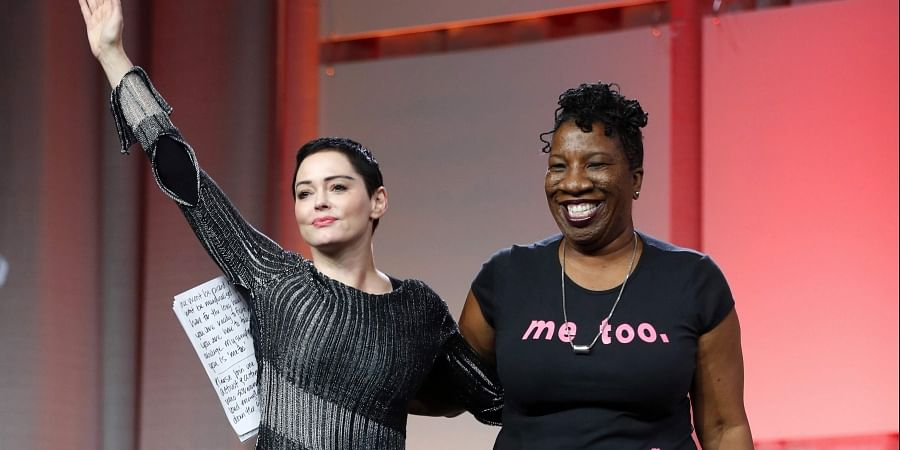 FILE - In this Oct. 27, 2017 file photo, actress Rose McGowan, left, waves after being introduced by Tarana Burke, right, founder of the #MeToo movement, at the inaugural Women's Convention in Detroit. (Photo | AP)