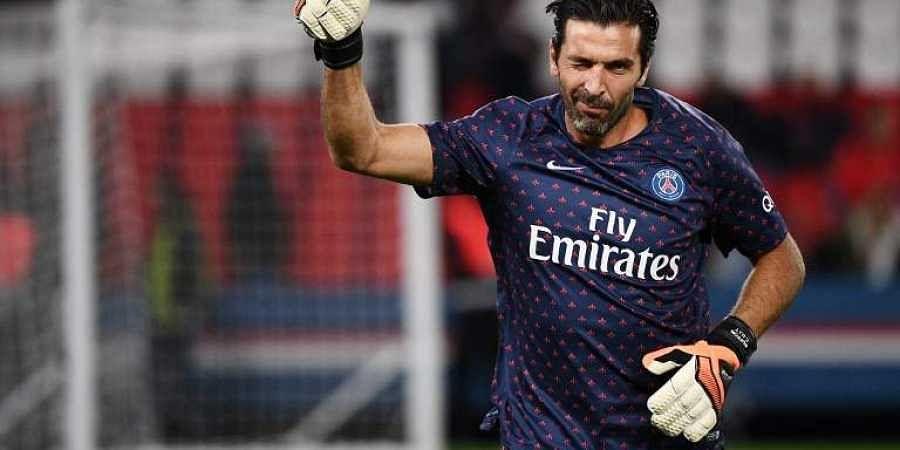 5d74a6c74 PSG s Italian goalkeeper Gianluigi Buffon salutes supporters during warm  up. (Photo